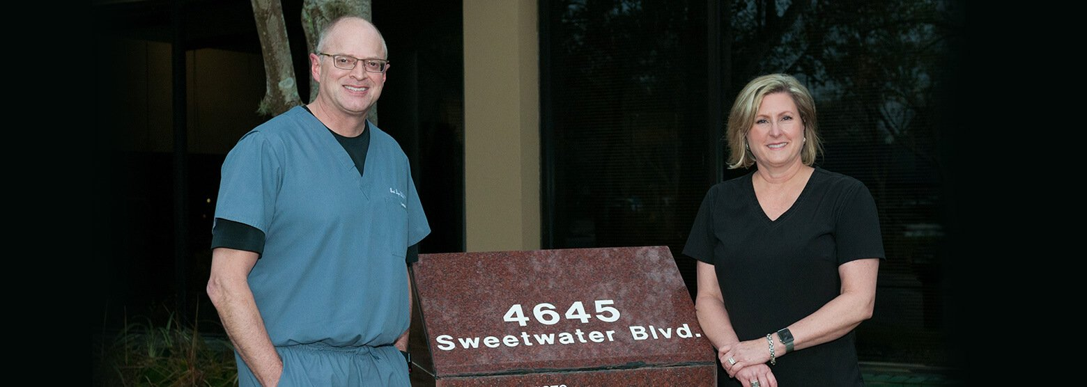 Outside photo of Dr. Dyer and his wife Jacque at Fort Bend Periodontics and Implantology