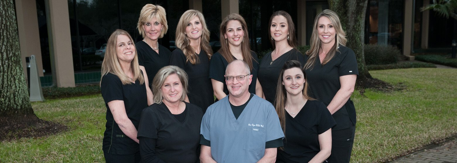 Outside group photo with Dr. Dyer and his staff at Fort Bend Periodontics and Implantology